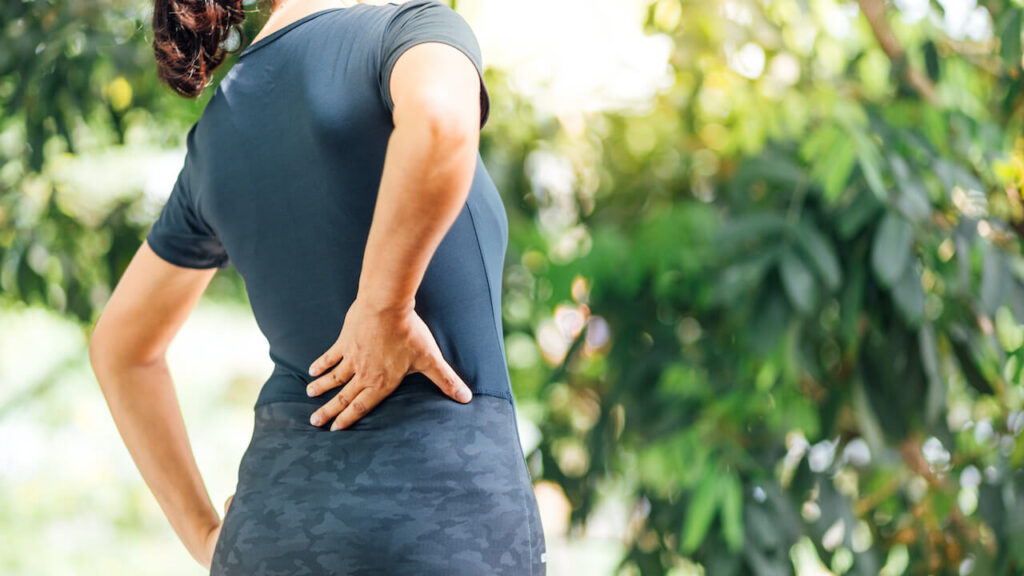 Young Asian women with back pain